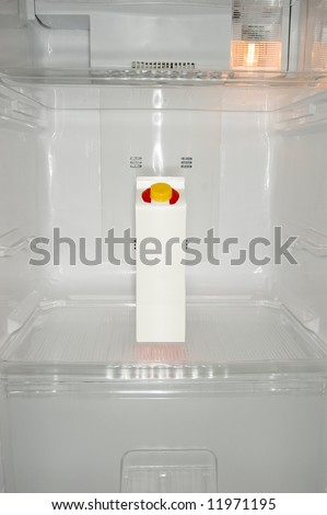 Milk carton inside a new refrigerator - stock photo