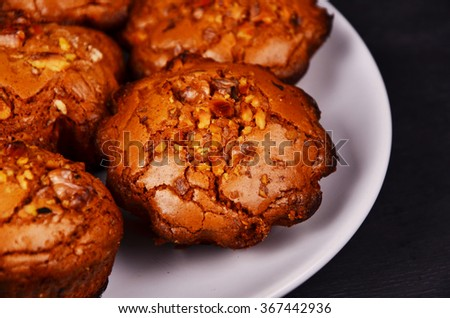 Milk Chocolate muffins with crispy top (selective focus)