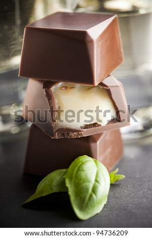 Milk Chocolate praline filled with a basil creme. - stock photo