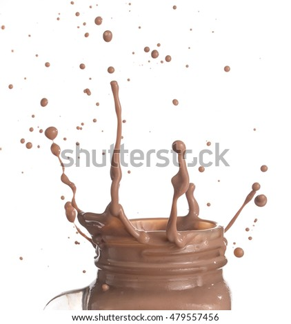 Milk chocolate splash over white background