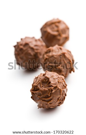 milk chocolate truffles on white background - stock photo
