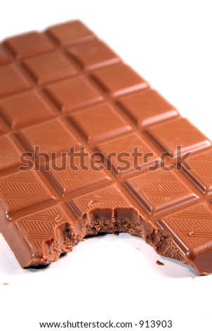 Milk chocolate with bite marks - stock photo