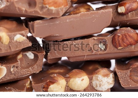 Milk chocolate with hazelnuts - stock photo