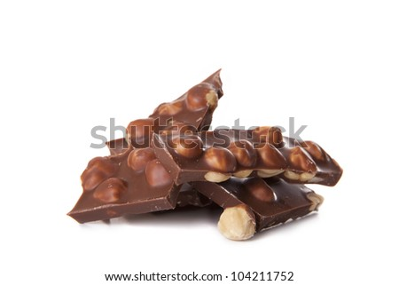 Milk chocolate with nuts on a white background - stock photo
