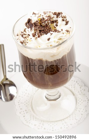 milk coffee in a glass cup with chocolate sprinkles