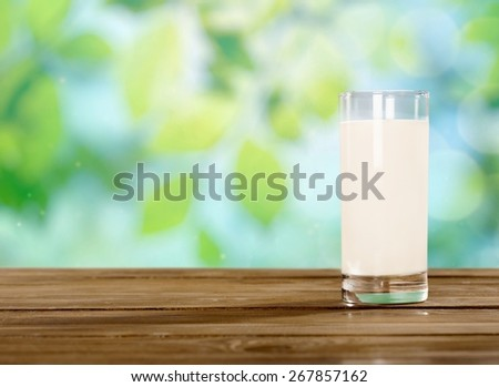 Milk, glass, field. - stock photo
