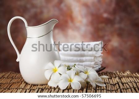 milk jar and the frangipani flower - stock photo