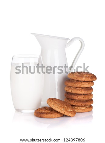 Milk jug, glass and cookies. Isolated on white background