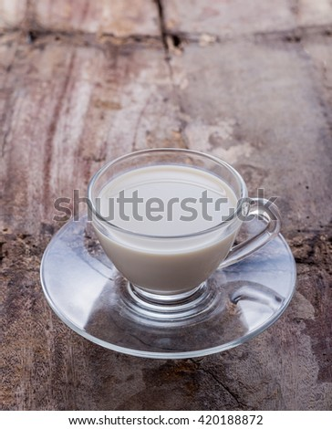 milk on old wooden floor  - stock photo