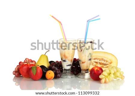 Milk shakes with fruit isolated on white close-up - stock photo