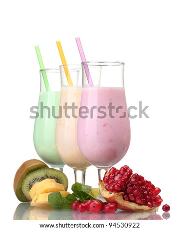 Milk shakes with fruits isolated on white - stock photo