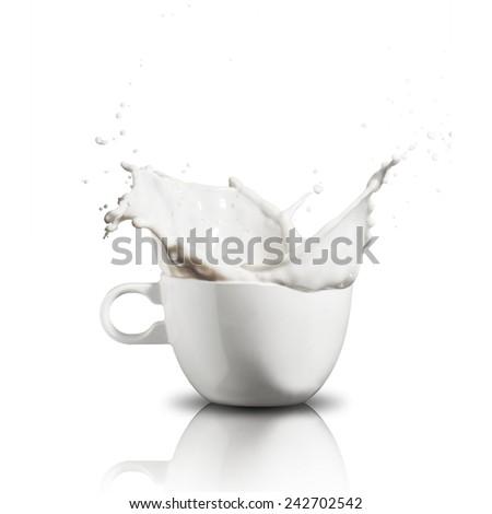 Milk Splash From Cup - stock photo
