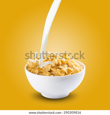 Milk Splash on Bowl of Cereal Corn Flakes - stock photo