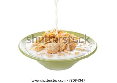 milk splash on the bowl full of corn flakes, healthy breakfast food - stock photo