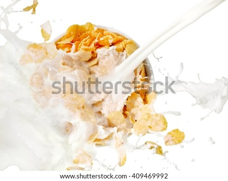Milk splash over a cup with cornflakes, top view - stock photo