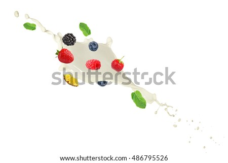 Milk splash with falling fresh tasty fruits isolated on white