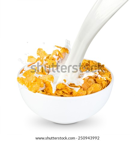milk splashes into corn flakes bowl - stock photo
