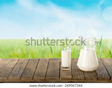 Milk, spring, grass. - stock photo