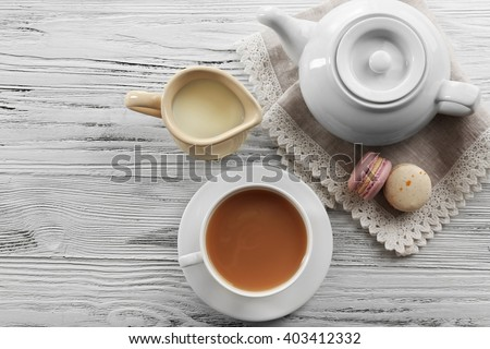 Milk tea with tea pot on white background. - stock photo