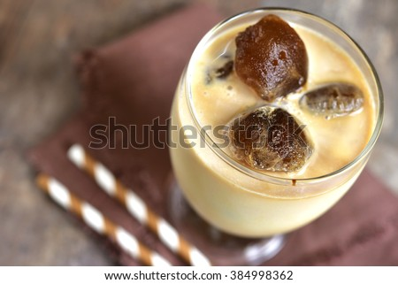 Milk with coffee ice cubes.Cold summer drink. - stock photo