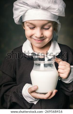 milkman boy holding a glass of milk - stock photo