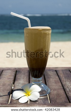 Milkshake on a tropical beach - stock photo