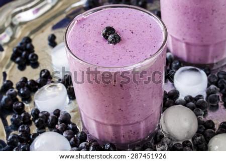 milkshake with blueberries, strawberries and vanilla ice cream - stock photo