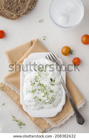 Milky appetizer with thyme with a drink - stock photo