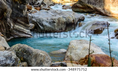 Milky blue glacial water of Parvati River in Himalayas, India
