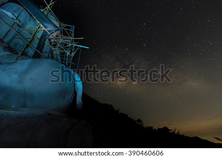 Milky way galaxy on sky and star with Thai buddha statue on hill  13 Mar 2016, Timelapse - stock photo