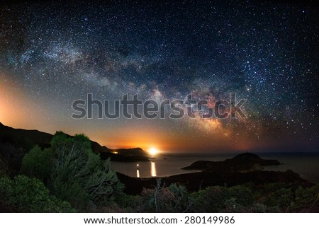 Milky way on over the Malfatano Cape  - stock photo