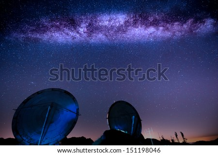 milky way over an old military radar installation - stock photo
