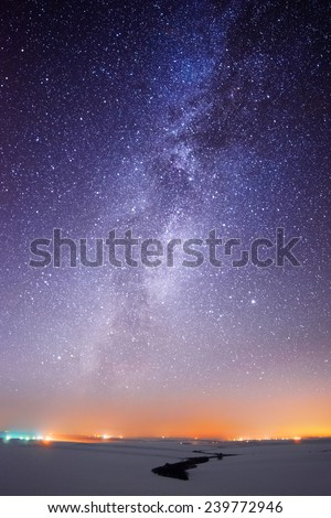Milky Way over the country lights - stock photo