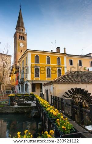 Mill on lemene river and clock tower, Portogruaro, Veneto, Italy - stock photo