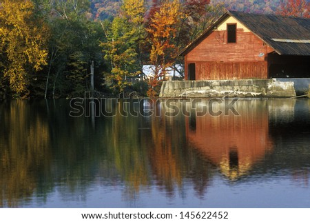 Mill on river in Autumn in VT - stock photo