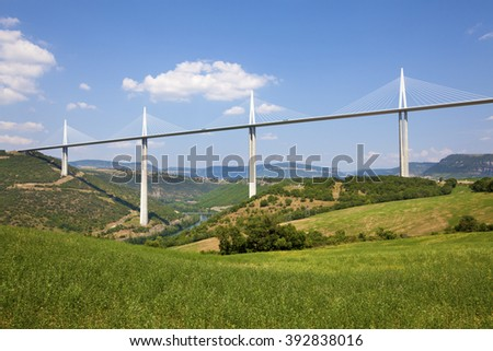 MILLAU, FRANCE - JULY 12, 2013: View of the Millau Viaduct, the tallest cable-stayed bridge over the Tarn valley in France, designed by the structural engineer Virlogeux and architect Foster. - stock photo