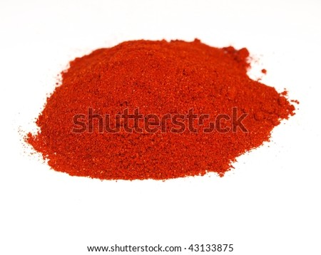 Milled red paprika on white background
