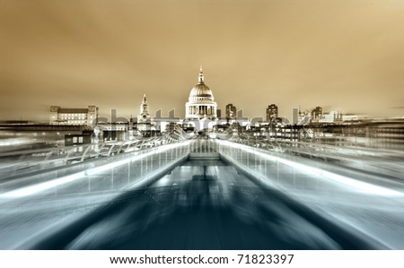 Millennium Bridge leads to Saint Paul's Cathedral in central London at night - stock photo