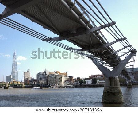 Millennium bridge over the Thames in London - stock photo