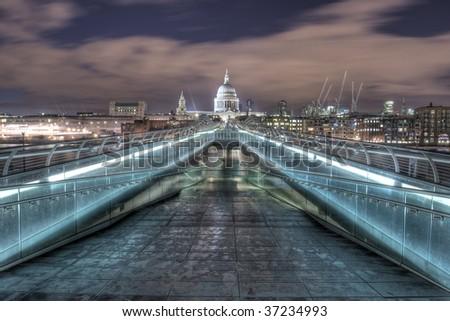 Millennium bridge to St Paul's cathedral - stock photo
