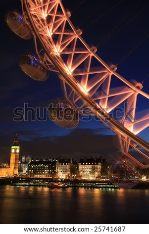 Millennium Wheel with River Thames and Big Ben behind - stock photo