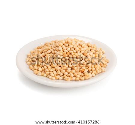 Millet on white background - stock photo