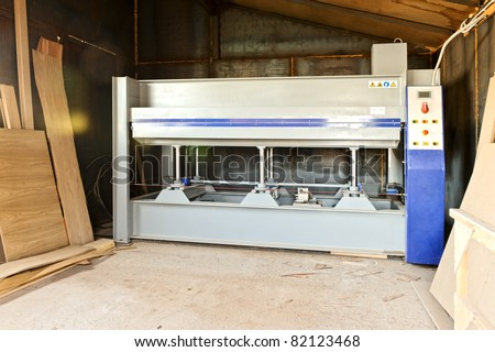 Milling and sawing machine for processing wood - stock photo