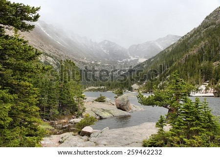 Mills Lake with misty Rocky Mountains in background. Landscape in Colorado. - stock photo