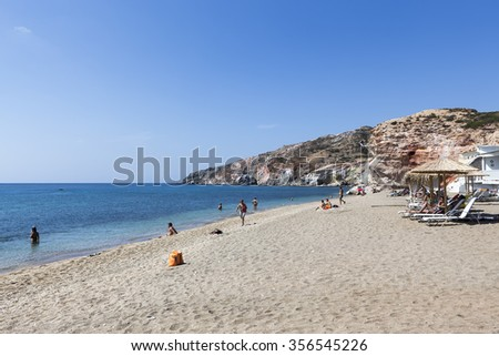 Milos, Greece - September 8, 2015: Tourists enjoy the clear water of the beautiful beach in Milos island, Cyclades, Greece