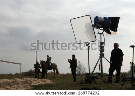 MILOVICE, CZECH REPUBLIC - OCTOBER 23, 2013: Actor dressed as a medieval knight rides a horse during the filming of the new movie The Knights near Milovice, Czech Republic. - stock photo