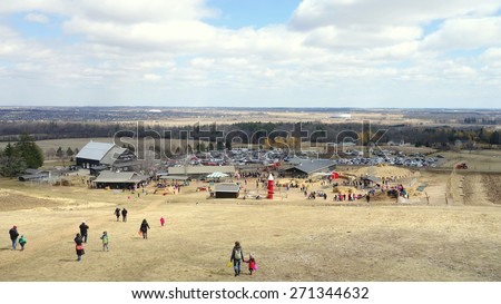 MILTON, CANADA - APRIL 4, 2015: A view of a farm and the hilly surroundings in Milton, Canada. - stock photo