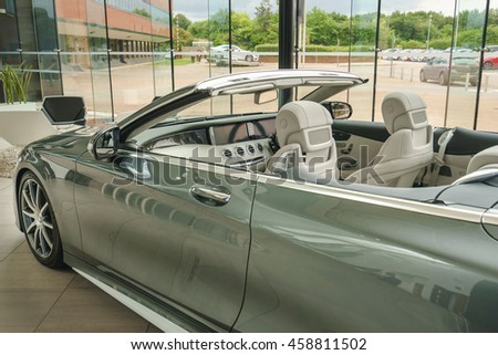 MILTON KEYNES, ENGLAND - JULY 26, 2016. Inside view of Mercedes Benz 2016 E Class Cabrio model at Mercedes-Benz head office  - stock photo
