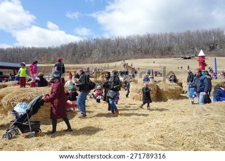 MILTON, ONTARIO - APRIL 4, 2015: Children and families visiting a farm in Milton, Ontario. - stock photo