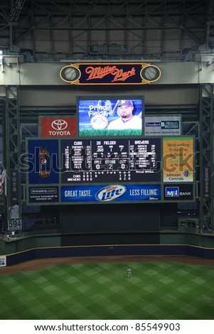 MILWAUKEE - APRIL 24: Baseball player Prince Fielder on the Miller Park scoreboard on April 24, 2010 in Milwaukee, Wisconsin. Fielder was selected by the Brewers in the first round of the 2002 draft. - stock photo